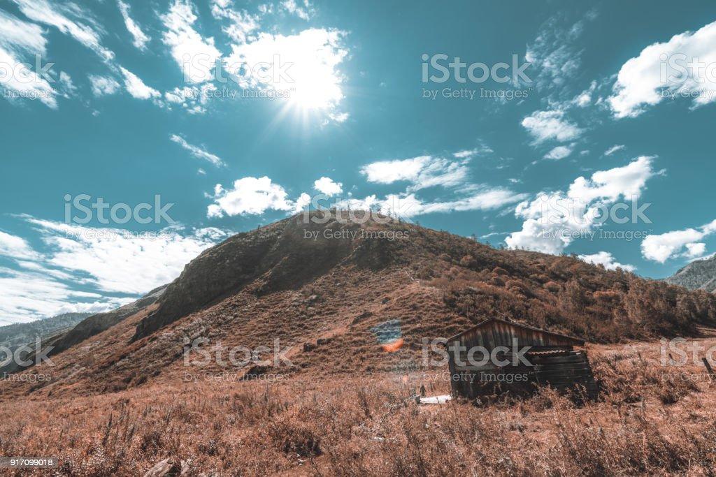 Forsaken cabin in mountains stock photo