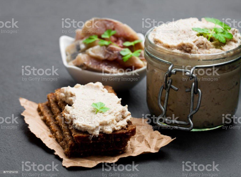 Forshmak  paste from herring on black stone background stock photo