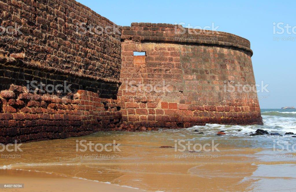 Fort Aguada's ramparts overlook Sinquerim Beach and the Arabian stock photo