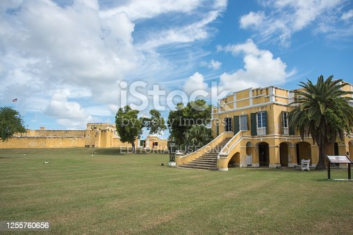 Christiansted, St. Croix, VI-October 22,2019: Danish customs house and Fort Christiansvaern under a blue sky with clouds in downtown Christiansted, VI