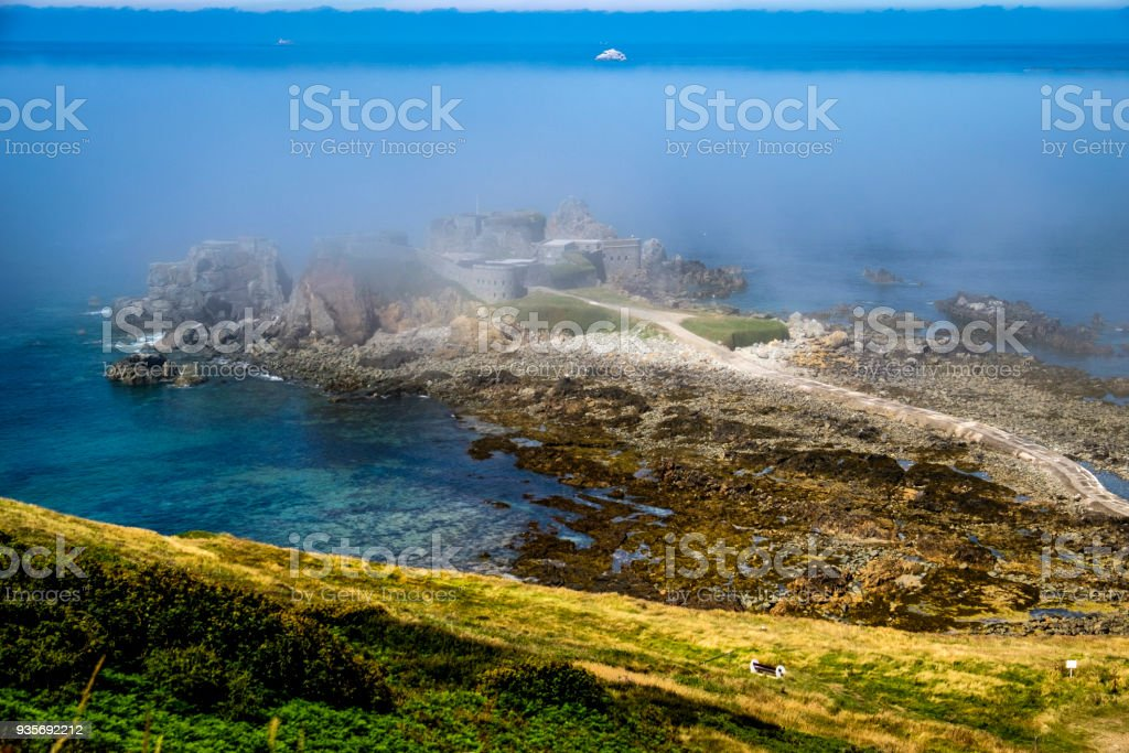 Fort Clonque in the morning fog, Alderney, Guernsey, Channel Islands stock photo