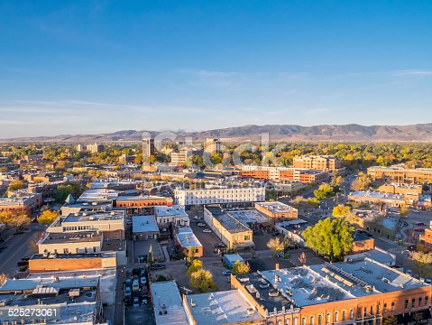 aerial view of Fort Collins downtown in sunrise light, shot from a low flying drone