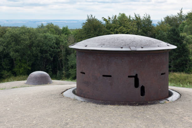 WW1 Fort Douaumont near Verdun in France with machine gun turret Fort Douaumont near Verdun in France with machine gun turret used in First World War One. It was raised for firing and then lowered for protection. verdun stock pictures, royalty-free photos & images