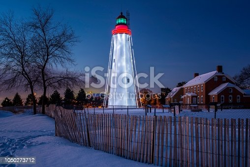 Fort Gratiot Lighthouse in snow with holiday lighting