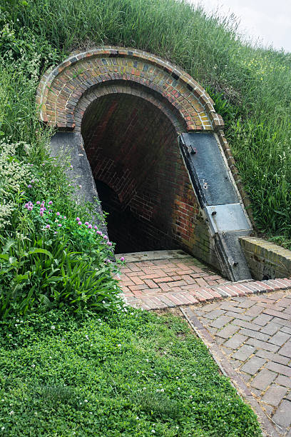 Fort McHenry Civil War Arched Brick Underground Tunnel Entrance Fort McHenry Civil War Arched Brick Underground Tunnel Entrance civil war memorial minnesota stock pictures, royalty-free photos & images