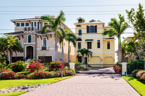 Fort Myers Beach, Florida with luxury houses buildings at waterfront with modern gated architecture stock photo