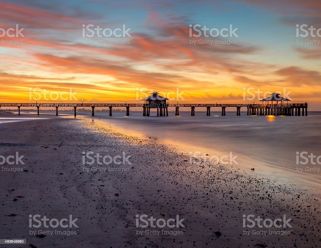 Fort Myers pier at dawn from the beach stock photo