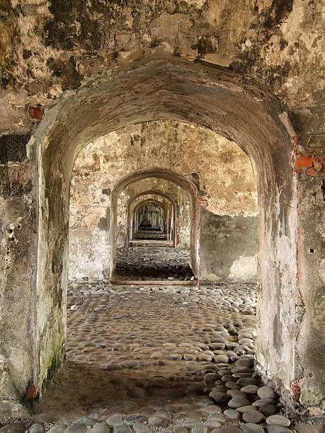 Fort San Juan De Ulua Arches Photo of arched hallway at Fort San Juan De Ulua in Veracruz Mexico.  This fort defended Mexico in 3 wars later serving as a prison, now it is a museum. veracruz stock pictures, royalty-free photos & images