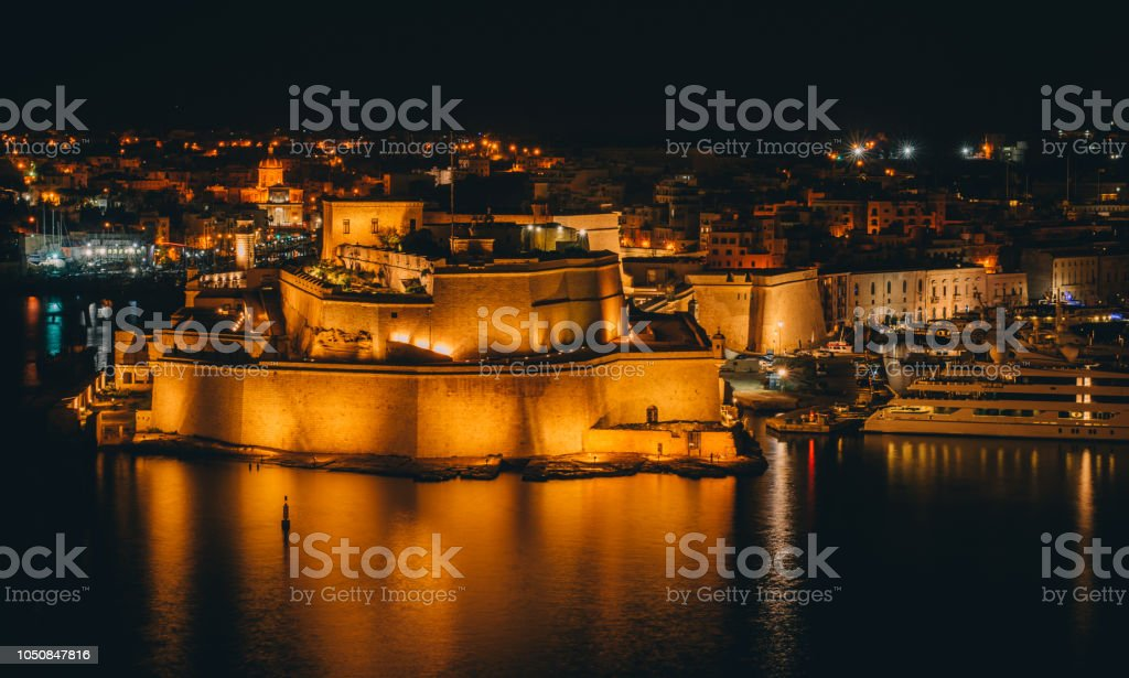 Fort St. Angelo, night Il-Birgu , view from Valletta stock photo