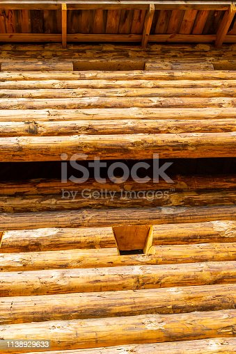 fort wooden wall beam pine window high impregnable defense war of the tradition of Europe. Vertical powerful tower wall roof up sunny day
