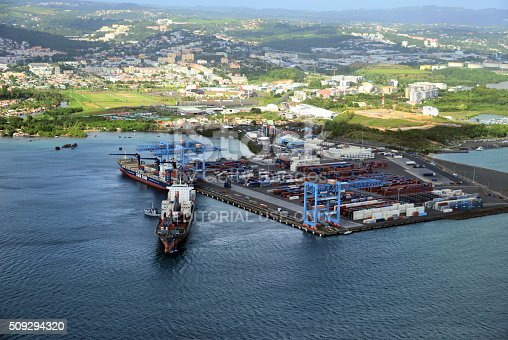 Fort-de-France, Martinique - January 28, 2016: a freighter ship leaves the container terminal