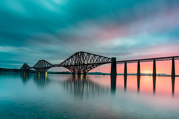 Forth Bridge at Sunrise The famous Forth Bridge during a summer sunrise. edinburgh scotland stock pictures, royalty-free photos & images