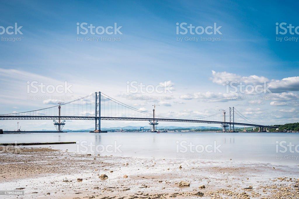 Forth Road Bridge at low tide stock photo