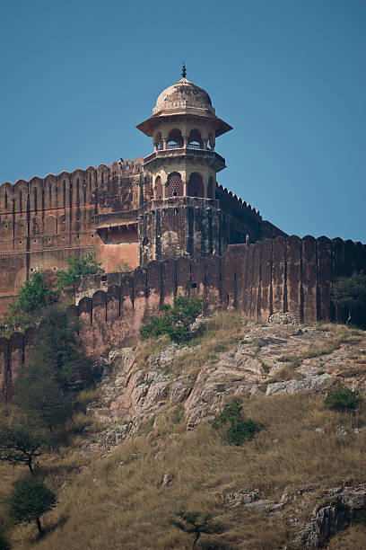 Fortification of Amber Fort near Jaipur The Amber Fort, magnificent fortified palace  near Jaipur, Rajasthan, India. This maharajah residence situated upon Maota  Lake became in 2013 Unesco world heritage site. artistical stock pictures, royalty-free photos & images