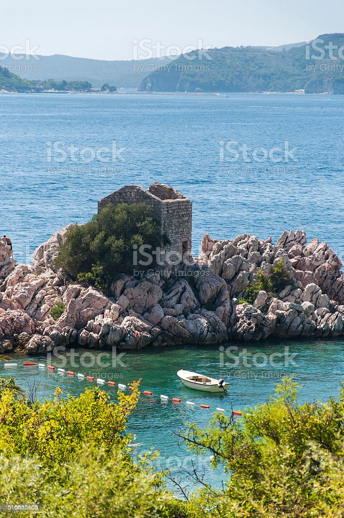 Fortress and a boat at the sea stock photo