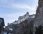 Salzburg, Austria - December 18, 2019: Fortress Hohensalzburg, one of the largest existing castles in Europe from the 11th century, towers over Mozart's city of Salzburg.