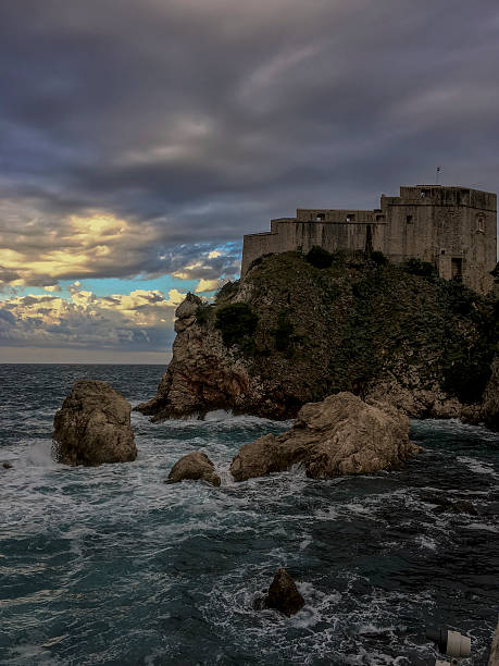 Fortress Lovrijenac with dramatic clouds with sunset peeking through ストックフォト