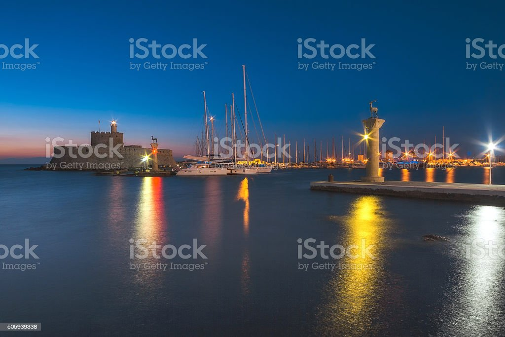 Fortress of St. Nicholas and sculpture Rhodes. stock photo