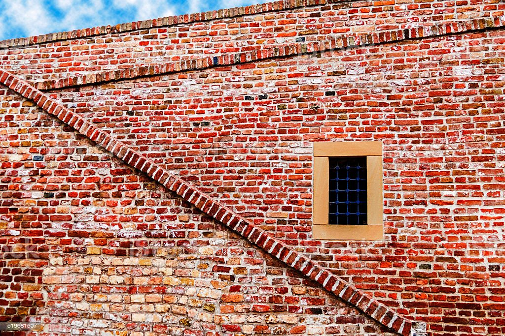 Part of old brick and stone wall, brick wall, with window, from...