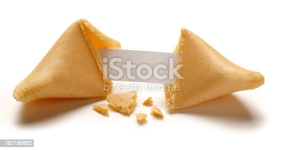 A fortune cookie is broken in half revealing a blank fortune inside.  Crumbs are scattered below and around the broken cookie.  Text can be added to the blank fortune. Image is isolated on white with a soft drop shadow.
