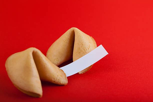 Fortune cookie on red paper stock photo