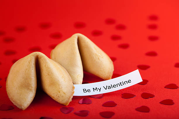Fortune cookies on red paper stock photo