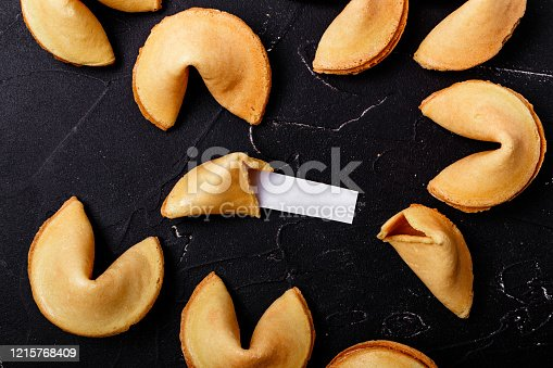 Fortune cookies on a black background, close-up.