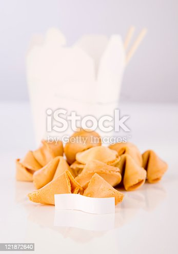 Fortune cookies sitting on a white counter.