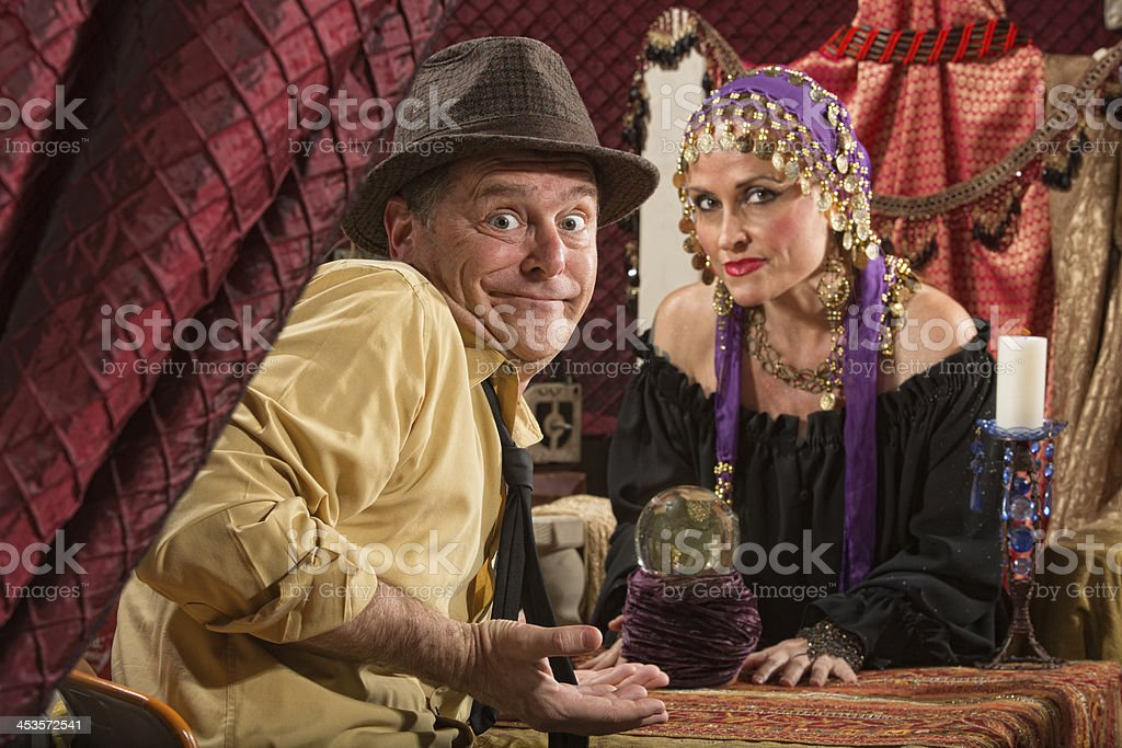 Fortune Teller and Skeptical Man stock photo