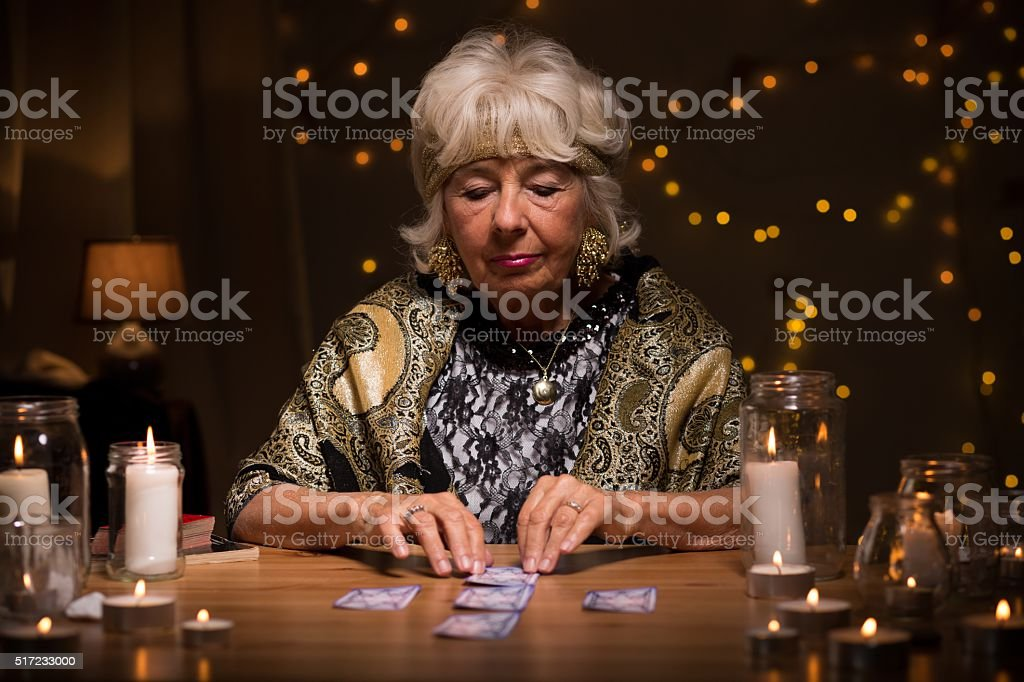 Fortune teller reading tarot cards stock photo