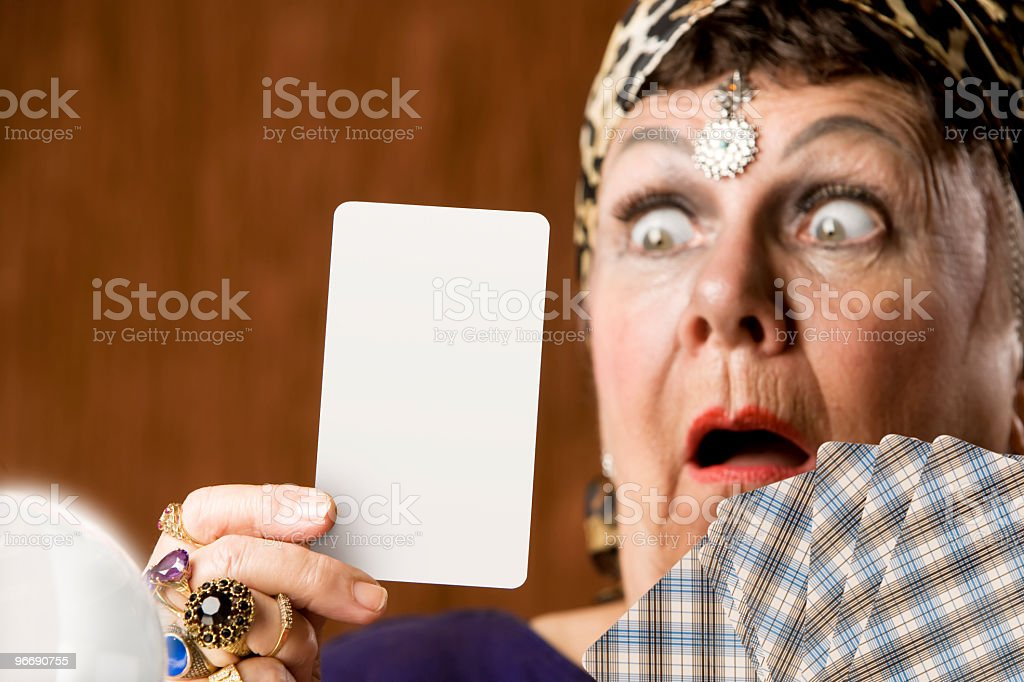 Fortune teller showing a blank Tarot card royalty-free stock photo