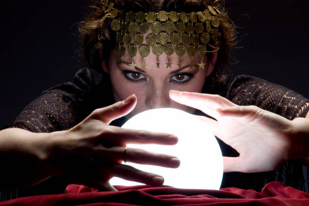 fortune teller with glowing crystal ball  romani people stock pictures, royalty-free photos & images