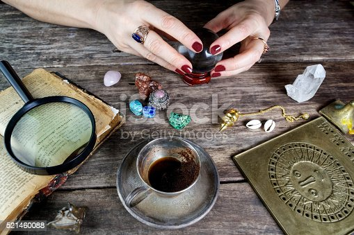 istock Fortune teller woman predicting future from cards 521460088