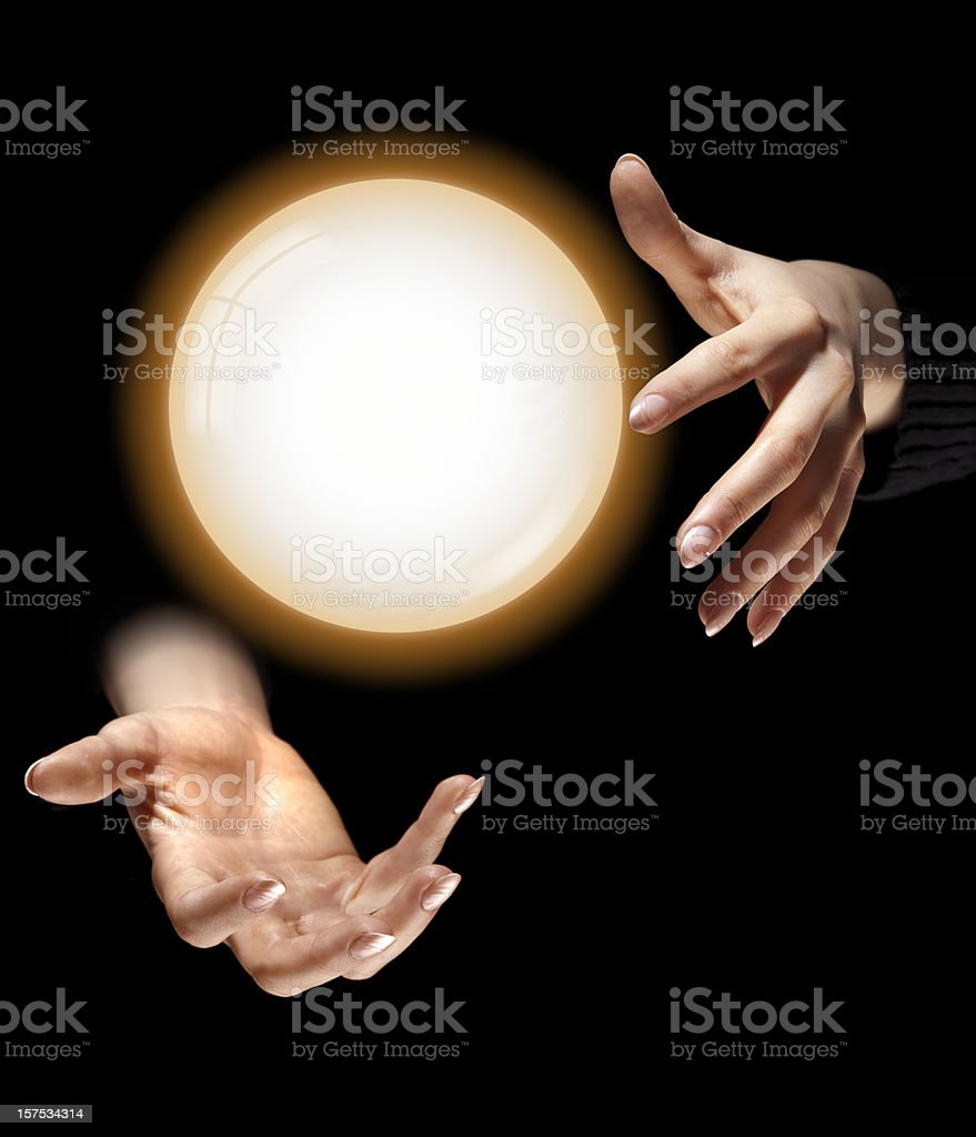Fortune Teller's Hands, Glowing Crystal Ball Floating Between, Black Background royalty-free stock photo