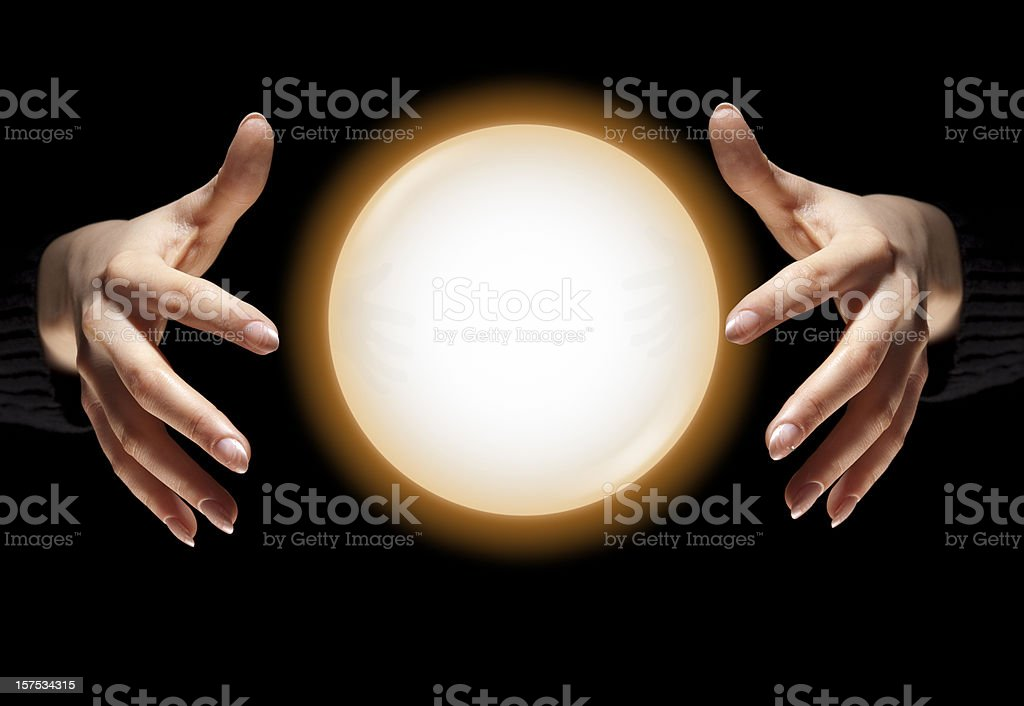 Fortune Teller's Hands With Glowing Crystal Ball, Dark Black Background stock photo