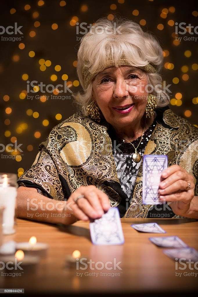Fortuneteller using tarot cards stock photo