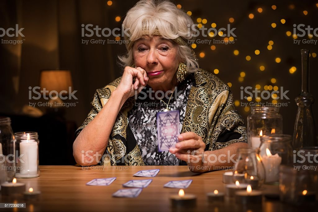 Fortune-teller with tarot cards stock photo