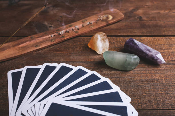 Fortune-telling tarot cards and mineral stones stock photo
