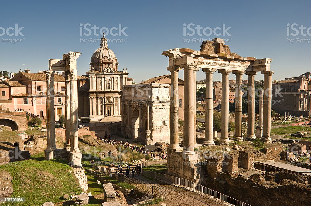 """Forum The Roman Forum (Latin: Forum Romanum), sometimes known by its original Latin name, is located between the Palatine hill and the Capitoline hill of the city of Rome. It is the central area around which the ancient Roman civilization developed. Citizens referred to the location as the """"Forum Magnum"""" or just the """"Forum"""". Ancient Stock Photo"""
