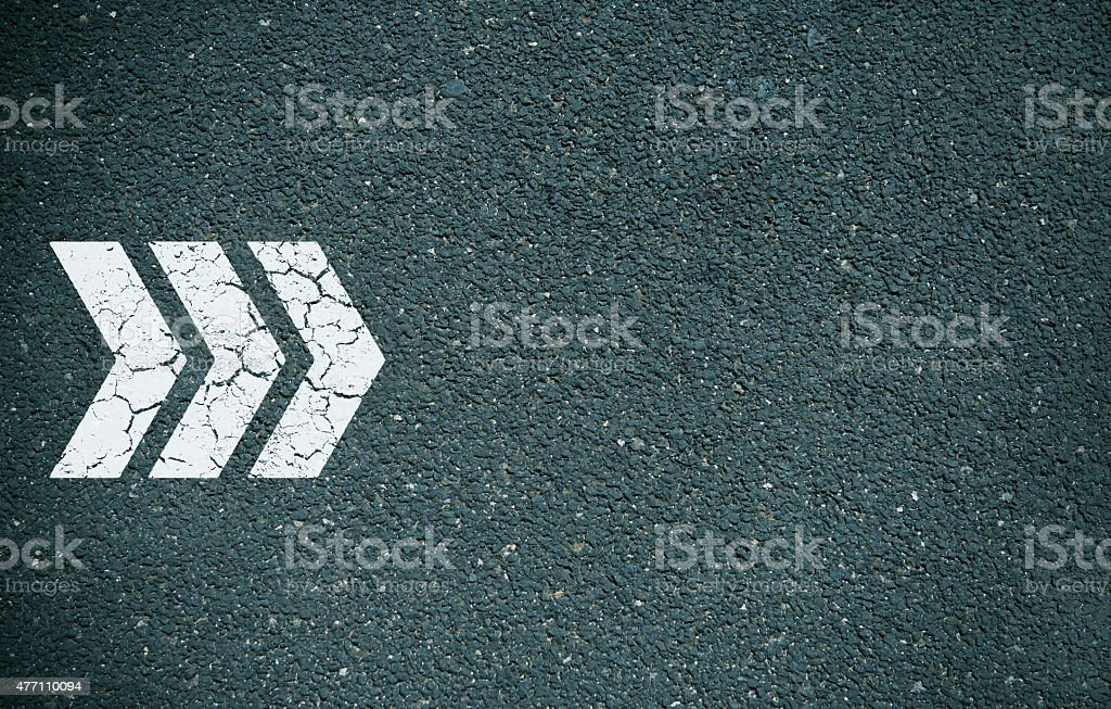 Forward arrow on tarmac stock photo