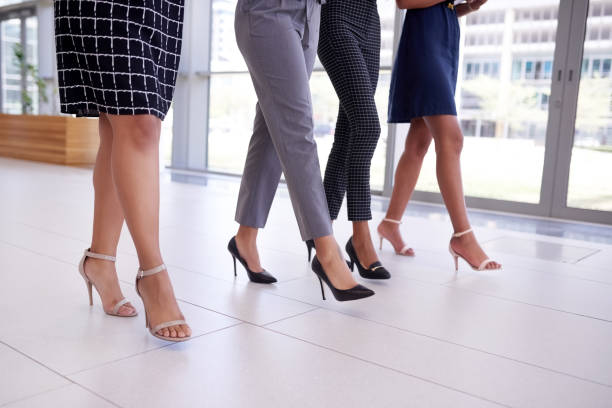 Forward is the only option in business Cropped shot of a group of young businesswomen walking through a modern office human foot stock pictures, royalty-free photos & images