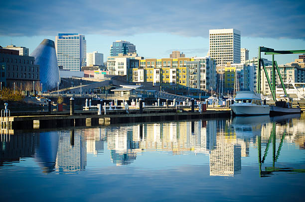 Foss Waterway with buildings and skyline in Tacoma, WA Skyline consisting of office buildings, condominiums and museums of Tacoma, WA reflects off of the Foss Waterway.  pierce county washington state stock pictures, royalty-free photos & images