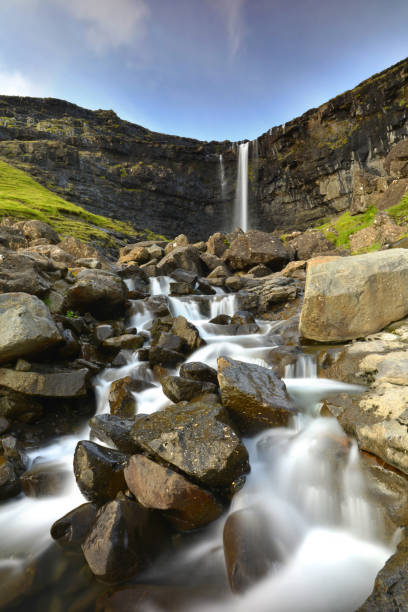 fossa waterfall - imagean faroe islands stock photos and pictures