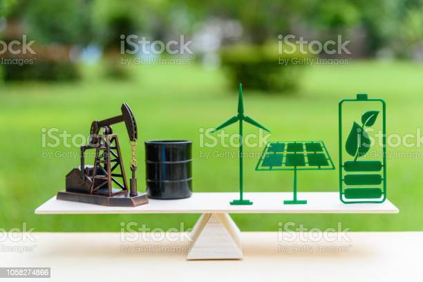 Fossil fuel vs renewable future clean alternative energy concept picture id1058274866?b=1&k=6&m=1058274866&s=612x612&h= kbtcrgvjt3dc0yddr94sl plqrswf3hj ioq3lz6me=