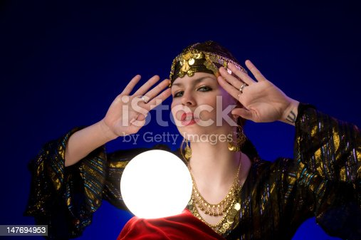 fortune-teller with a lit up crystal ball