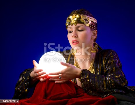 fortune-teller divines with crystal ball