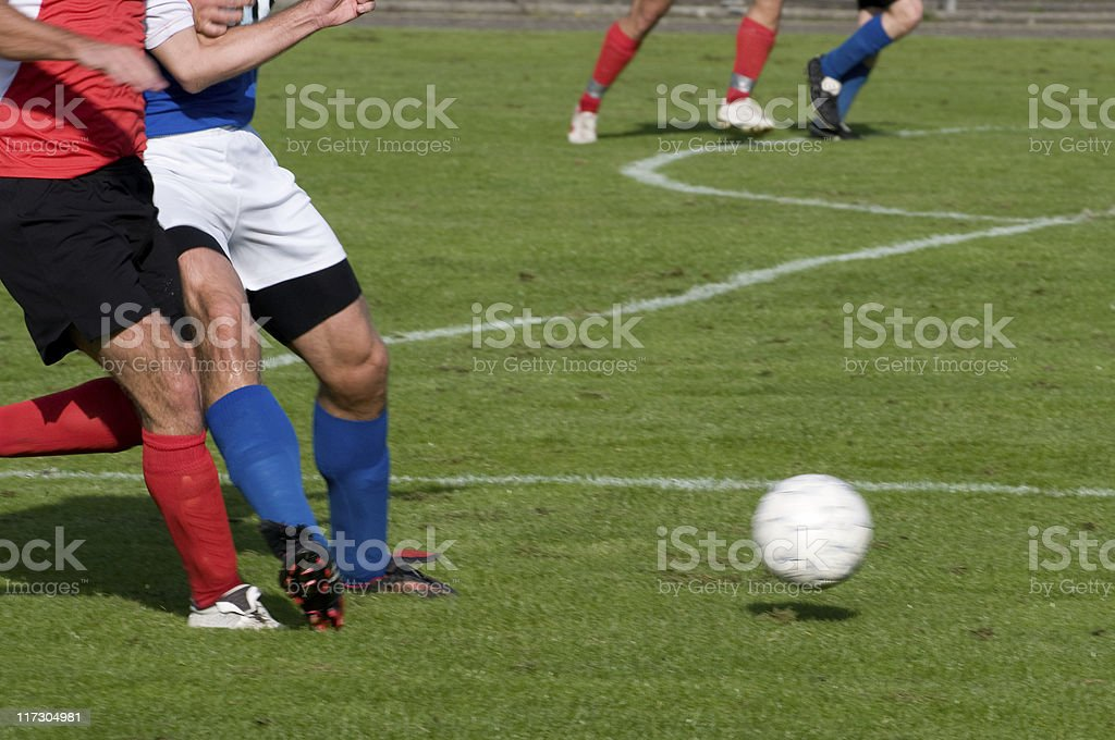 Foul Play commited by soccer player during football match stock photo