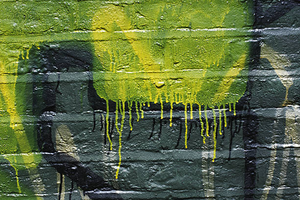 green yellow graffiti dripping on wall grunge pattern - whiteway graffiti stock photos and pictures