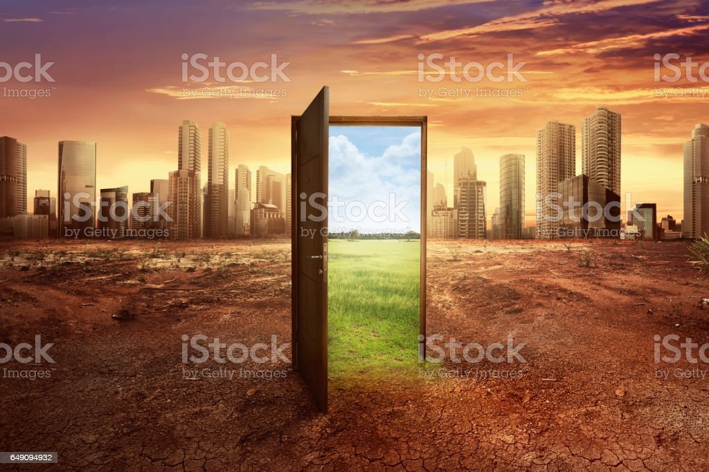 Found new world with green environment from open wooden door stock photo