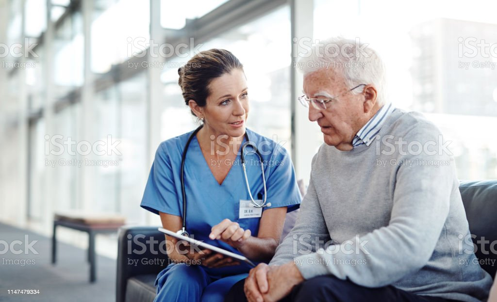 I found some entertainment for you Cropped shot of a female nurse showing her patient something on a digital tablet 70-79 Years Stock Photo